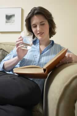 woman relaxing and reading great  6-traits books about writing