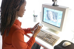 Young woman noting 6-trait web resources organized by trait